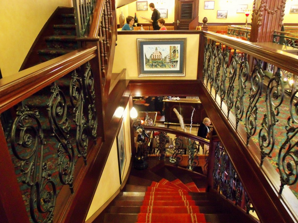Beautiful staircase at Café des Tribunaux and another view to match the postcard!