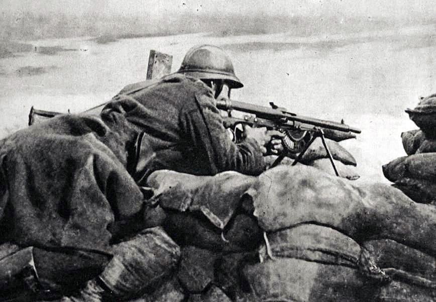 Belgian machine gunner guarding a trench, 1918