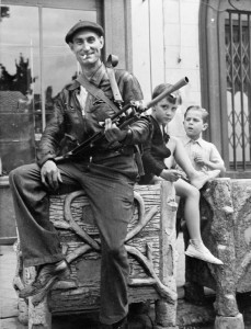 Watched by two small boys, a member of the FFI (French Forces of the Interior) poses with his Bren gun at Chateaudun