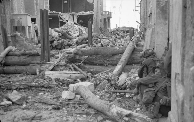 Fighting their way through the town of Saint-Aubin-sur-Mer 6 June 1944