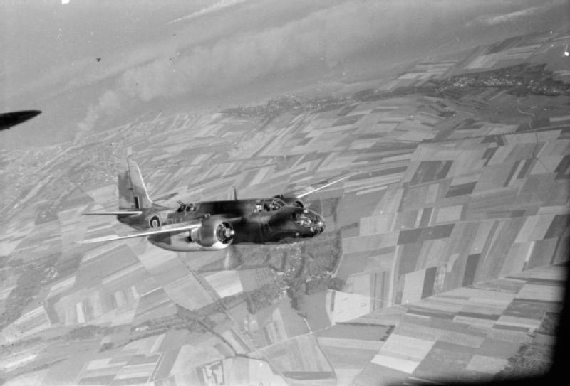A Douglas Boston Mark III of No. 88 Squadron RAF, flying from Ford, Sussex, heads inland over France after the bombing the German gun batteries defending Dieppe.  Dieppe is top left.