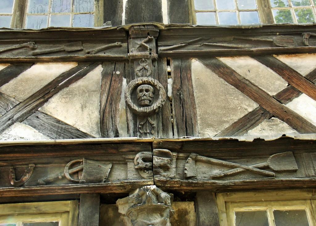 Deathly carvings in L' aître Saint-Maclou in Rouen