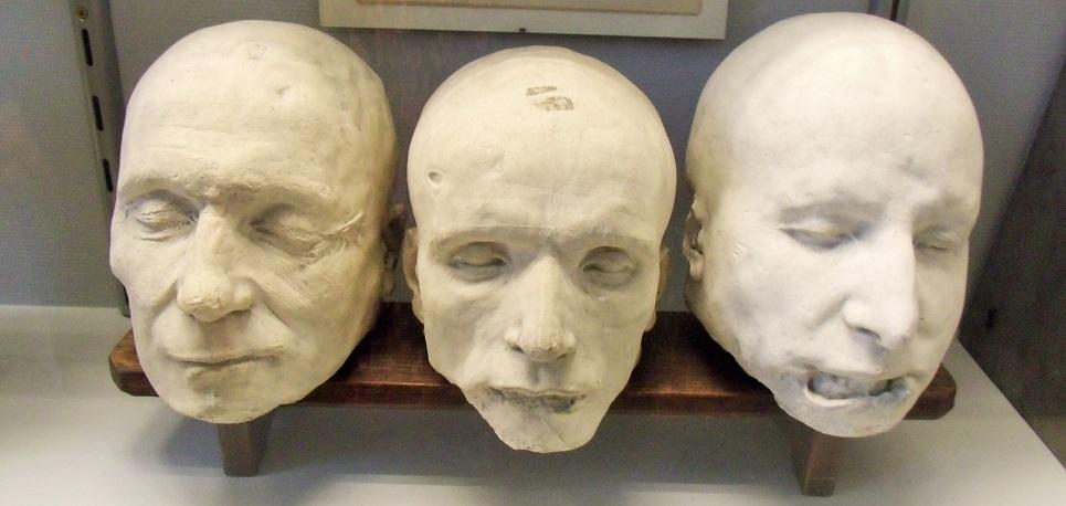 Death masks of guillotine'd family of criminals