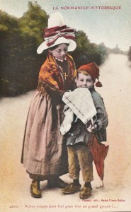 girl and boy in traditional normandy costumes postcard carte postale hand tinted