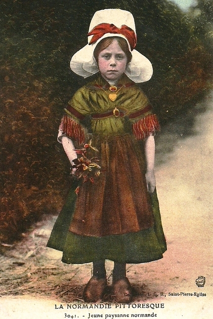 This postcard of a young Normandy peasant girl in traditional costume is we think a good likeness for our guest blogger, age 8