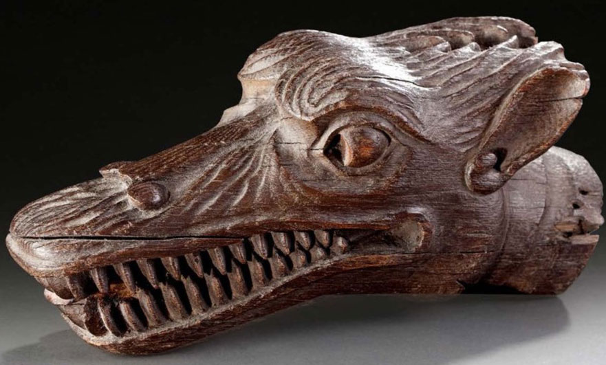 16th century carving of a wolf taken from a Normandy house beam