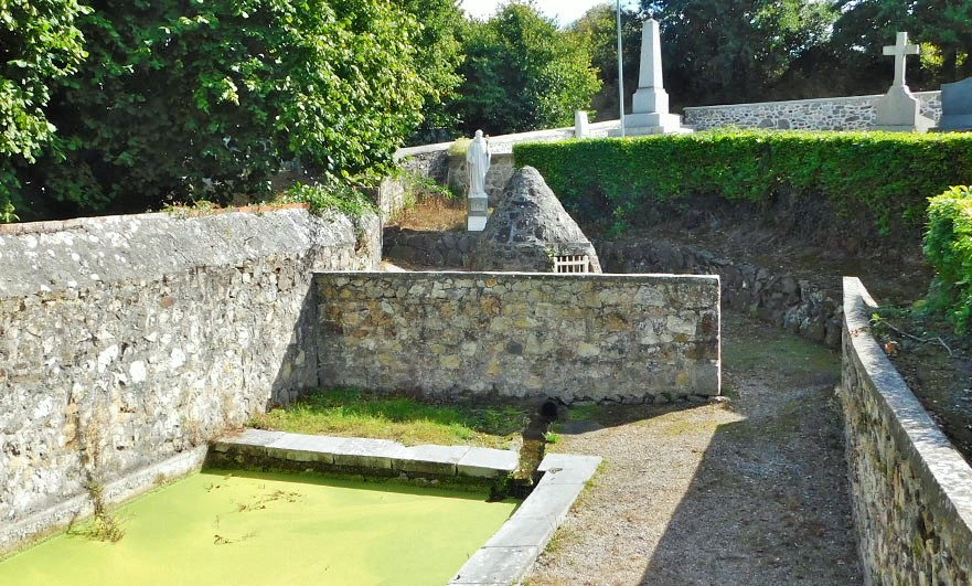 fontaine-st-helier-with-statue-at-breville-sur-mer-in-the-manche-match