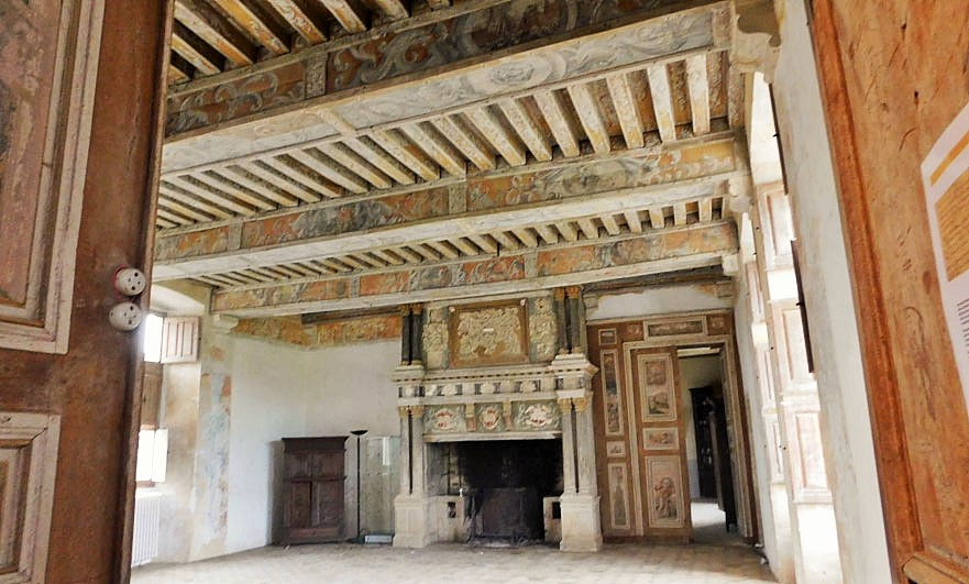 Chateau-de-Crosville-interior-with-painted-wood-panels-and-beams-in-yellow-and-grey