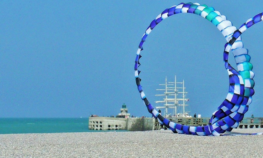 The Esmeralda sails out of Dieppe during the annual kite festival