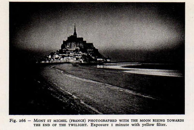 Mont Saint-Michel at twilight from Larousse's Encyclopedia of Astronomy