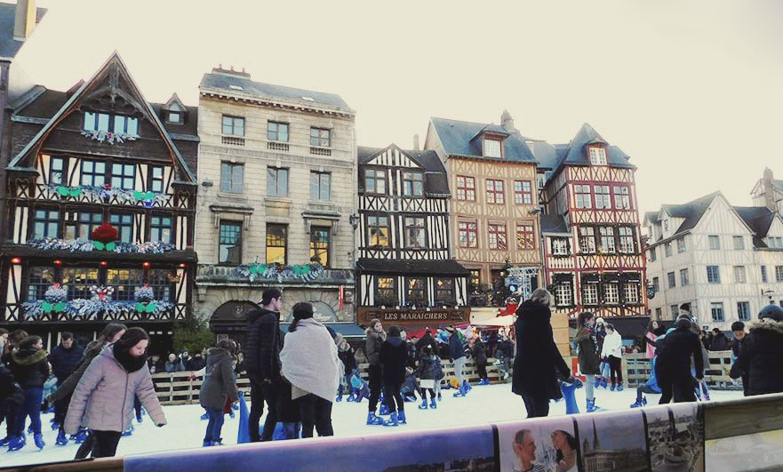 Ice rink in the old market square Rouen, Christmas 2017. La Couronne is the timber building on the left.