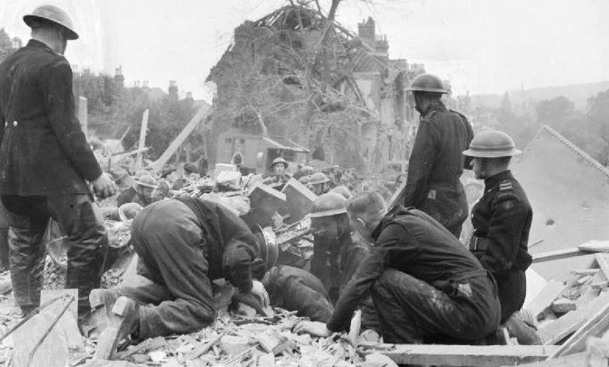 Hunt for survivors in wreckage caused by a V-1 bomb in London, England, 1944