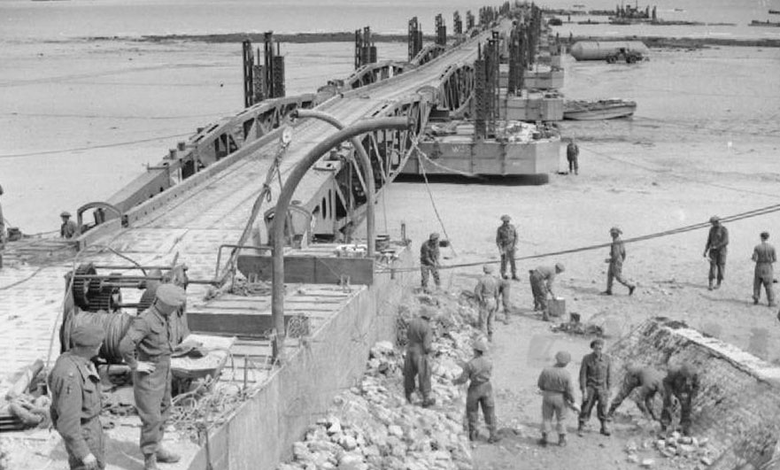 Engineers at work on the roadway leading to the Mulberry artificial harbour at Arromanches 14 June 1944