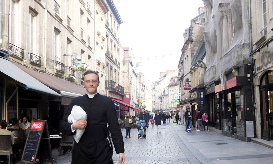 Rue Ecuyere Caen postcard match and priest photobomb!